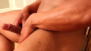 Ripped black stud stroking his cock